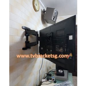 tv bracket install at kitchen wall tiles
