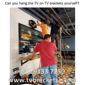 Can you hang the TV on TV brackets yourself in Singapore